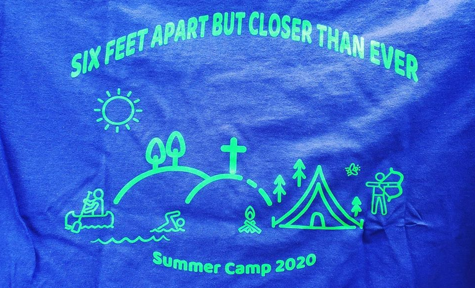 "T-shirt front that says ""Six Feet Apart but Closer than Ever"" and has an outline of a camp saying ""Summer Camp 2020"" at the bottom."